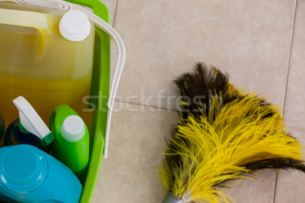 Bucket with cleaning supplies and mop on tile floor Stock photo © wavebreak_media