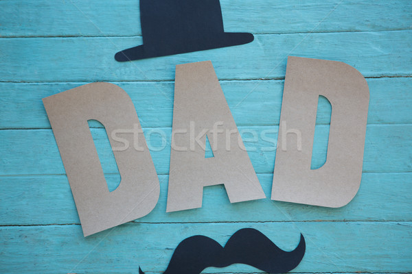 Close up of dad text with mustache and hat on table Stock photo © wavebreak_media