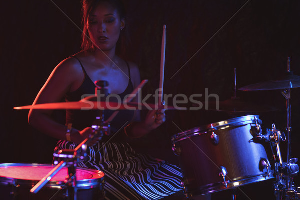 Female drummer playing drum kit in nightclub  Stock photo © wavebreak_media