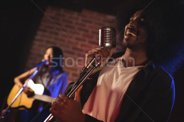 Male singer with female guitarist performing in nightclub Stock photo © wavebreak_media
