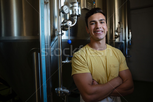 Portrait of male worker with arms crossed by storage tanks Stock photo © wavebreak_media