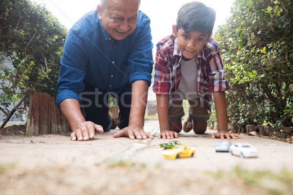 Boy and grandfather playing with toy cars Stock photo © wavebreak_media