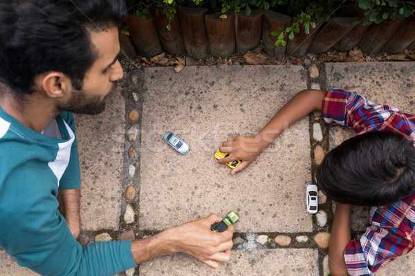 High angle view of father and son playing with toy car Stock photo © wavebreak_media