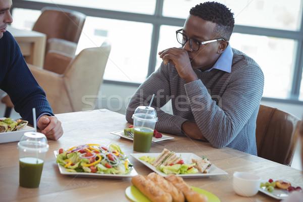 üzlet kollégák reggeli iroda büfé asztal Stock fotó © wavebreak_media