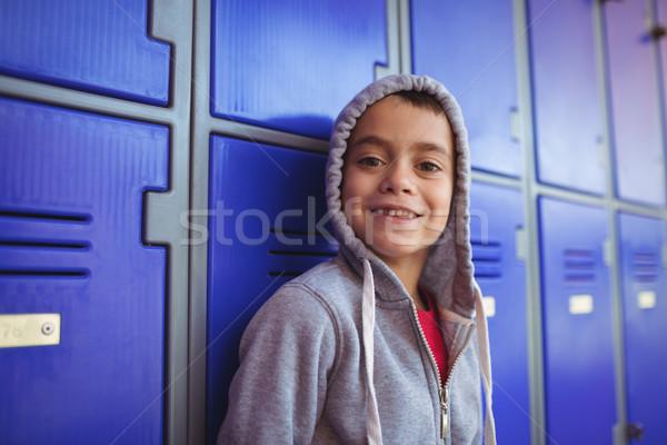 Portrait of smiling boy standing by lockers Stock photo © wavebreak_media