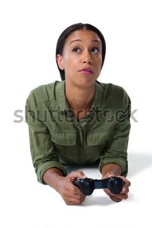 Mujer jugando videojuegos blanco mujer hermosa tecnología Foto stock © wavebreak_media
