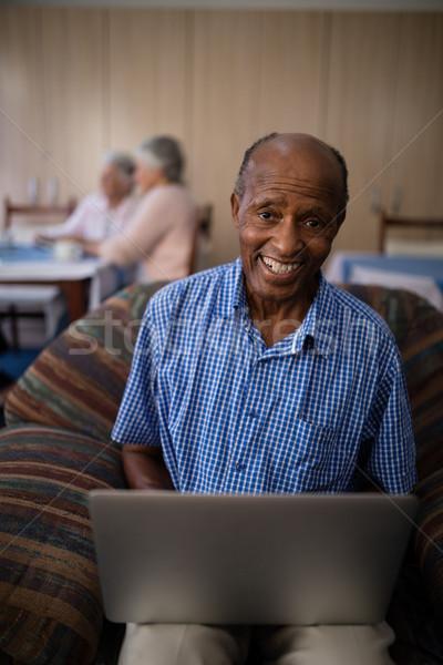 Portre mutlu kıdemli adam dizüstü bilgisayar kullanıyorsanız oturma Stok fotoğraf © wavebreak_media