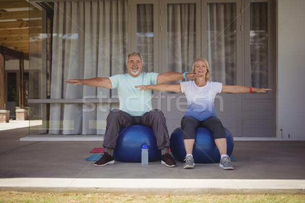 Senior couple doing stretching exercise on exercise ball Stock photo © wavebreak_media