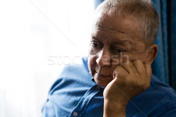 печально старший человека стороны подбородок сидят Сток-фото © wavebreak_media