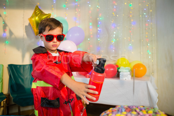 Cute boy pretending to be a fireman during birthday party Stock photo © wavebreak_media