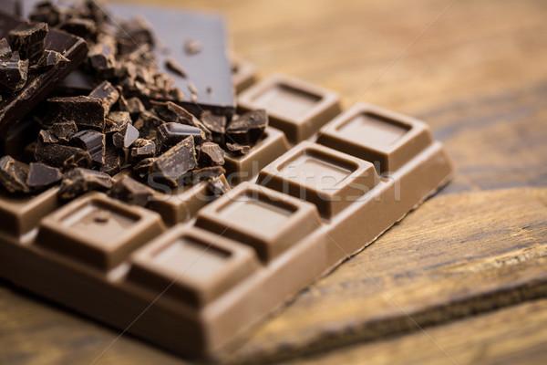 Dark and milk chocolate on a wooden table Stock photo © wavebreak_media