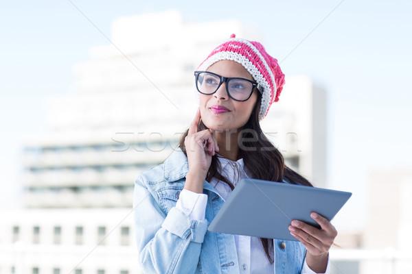 Figyelmes nő tart táblagép ujj arc Stock fotó © wavebreak_media