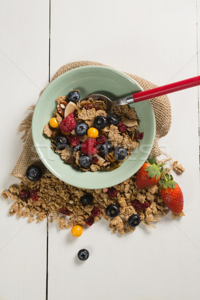 Bowl of breakfast cereals and fruits with spoon Stock photo © wavebreak_media