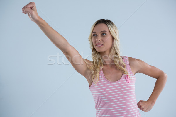 Young woman acting at super hero Stock photo © wavebreak_media
