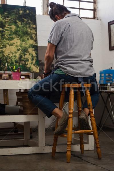 Attentif homme peinture table classe peinture Photo stock © wavebreak_media