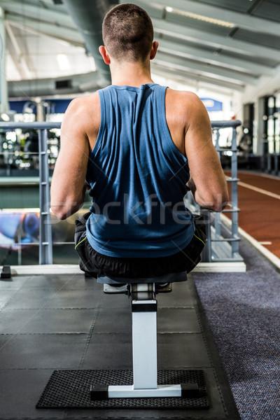 Muscular man using rowing machine  Stock photo © wavebreak_media