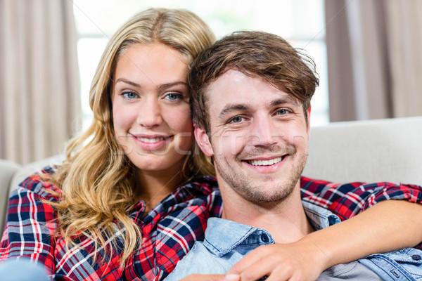Bonitinho casal sofá sala de estar homem Foto stock © wavebreak_media