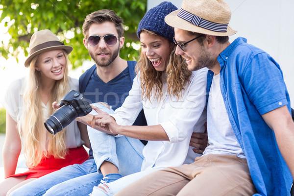 Hip friends taking pictures Stock photo © wavebreak_media