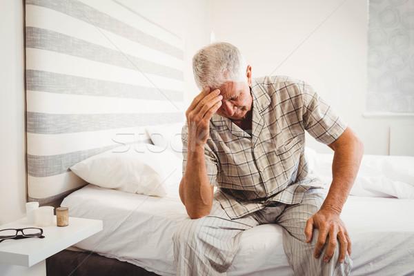 Csalódott idős férfi ül ágy hálószoba Stock fotó © wavebreak_media
