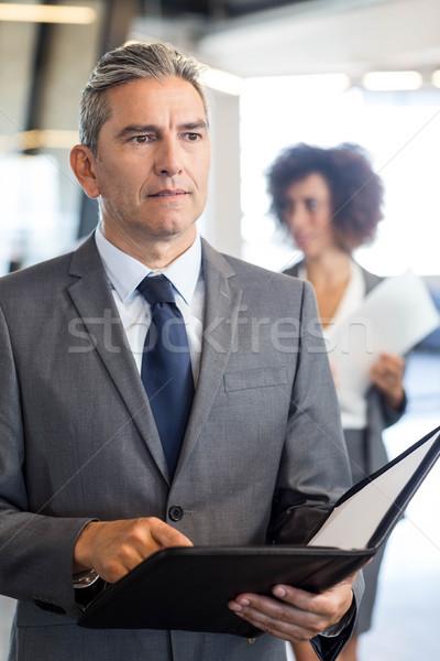 Gens d'affaires document organisateur bureau affaires homme Photo stock © wavebreak_media