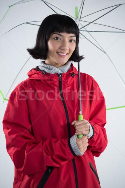 女性 赤 ジャケット 傘 笑顔の女性 ストックフォト © wavebreak_media