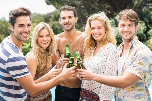 группа друзей пива бутылок улыбаясь Сток-фото © wavebreak_media