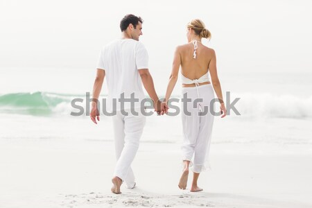 Couple holding hands at the beach Stock photo © wavebreak_media
