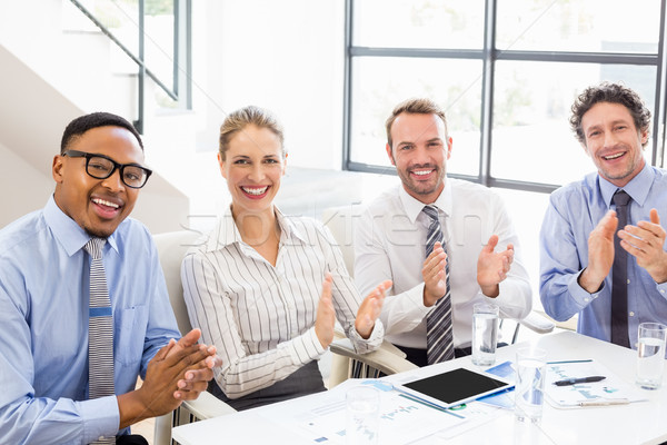 Businesspeople applauding while in a meeting Stock photo © wavebreak_media