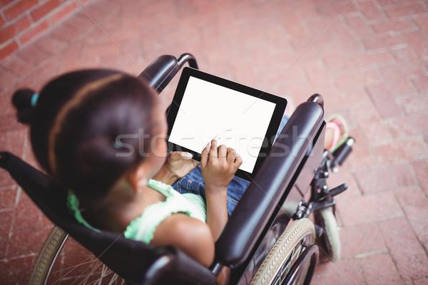 Superior vista nina silla de ruedas feliz Foto stock © wavebreak_media
