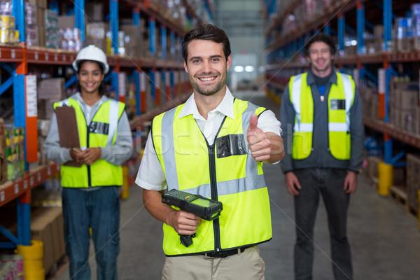 Munkás hüvelykujj felfelé visel citromsárga mentőmellény Stock fotó © wavebreak_media