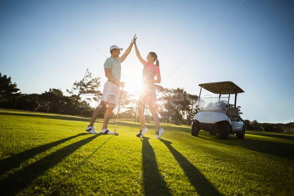 Boldog golfozó pár pacsi áll mező Stock fotó © wavebreak_media