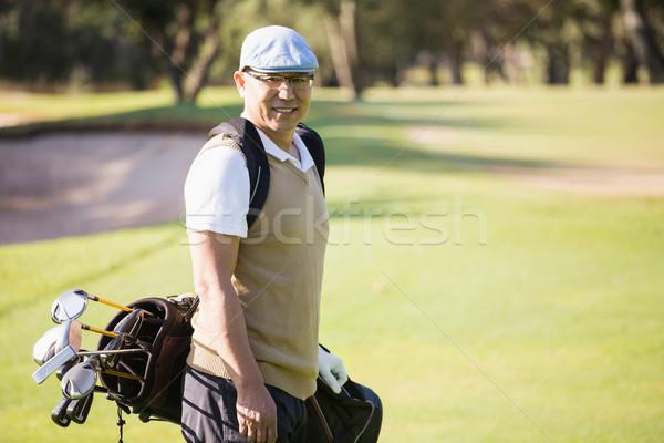 Sportoló pózol golftáska mező golf boldog Stock fotó © wavebreak_media