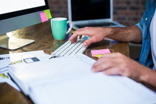 Cropped image of businessman working in office Stock photo © wavebreak_media