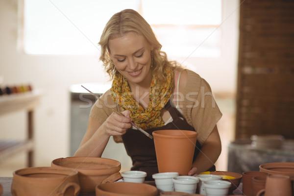 Bella femminile pittura pot ceramica workshop Foto d'archivio © wavebreak_media