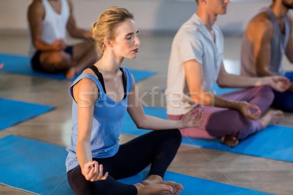 Young woman performing yoga Stock photo © wavebreak_media