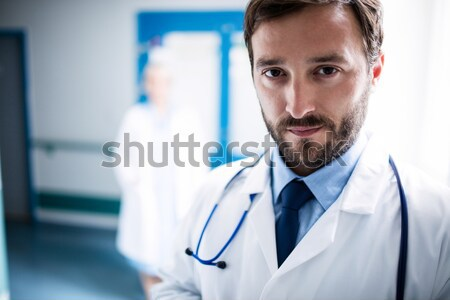 Male surgeon standing with arms crossed in operation room Stock photo © wavebreak_media