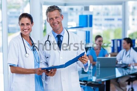 Ritratto chirurghi infermiera piedi ospedale felice Foto d'archivio © wavebreak_media