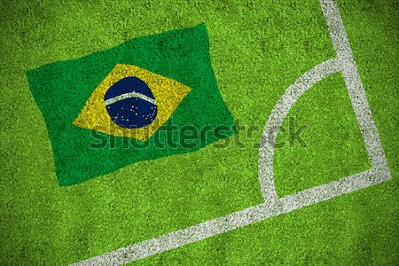 Football in brasil colours against green background Stock photo © wavebreak_media