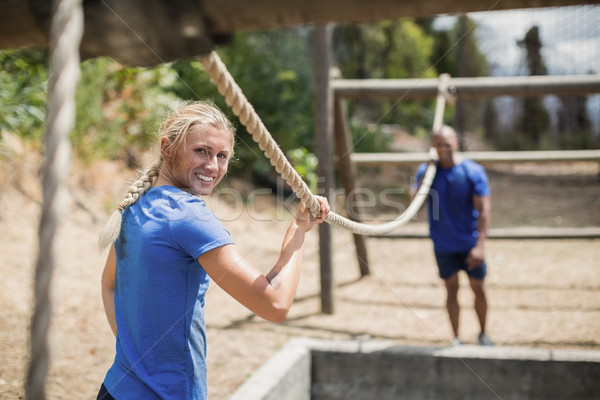 Fit man and woman practicing during obstacle course Stock photo © wavebreak_media