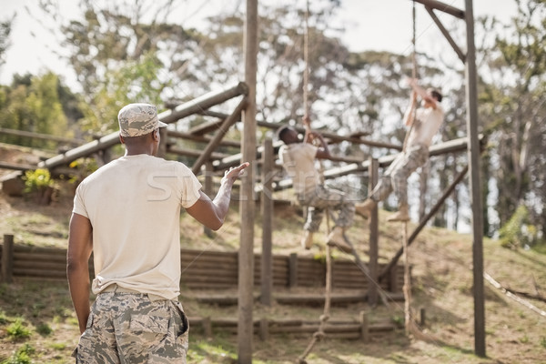 Military soldiers climbing rope during obstacle course training Stock photo © wavebreak_media
