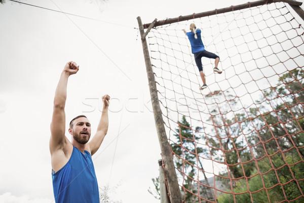 Kobieta wspinaczki netto drzewo fitness Zdjęcia stock © wavebreak_media