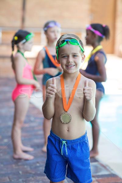 Piccolo nuotatore ragazza felice Foto d'archivio © wavebreak_media