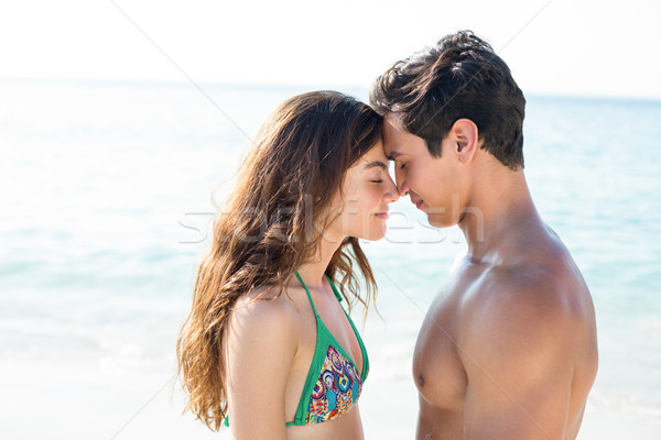 Couple standing face to face with eyes closed at beach Stock photo © wavebreak_media