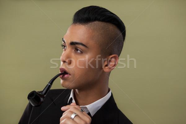 Close up of transgender woman with smoke pipe Stock photo © wavebreak_media