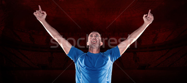 Composite image of happy rugby player with arms raised Stock photo © wavebreak_media