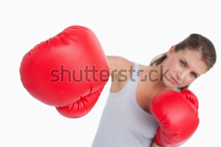 Standing woman for breast cancer awareness with ribbon and boxing gloves on white background Stock photo © wavebreak_media