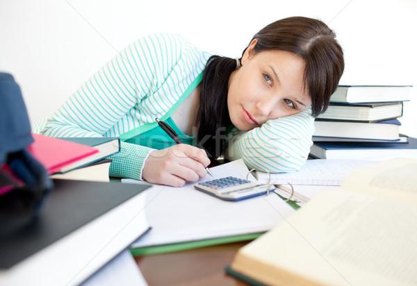 Agacé adolescente étudier bureau livre étudiant Photo stock © wavebreak_media