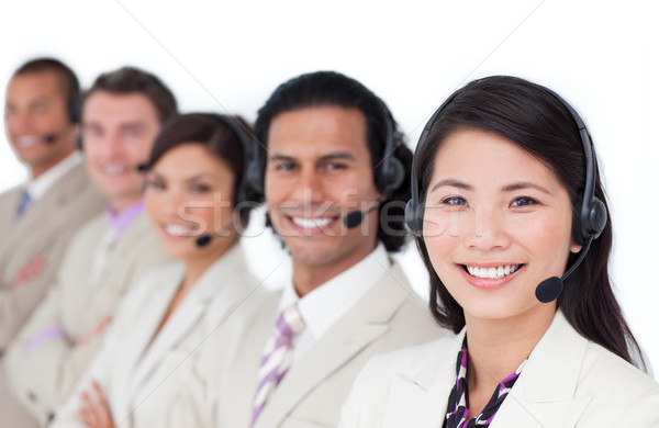 Enthusiastic business team lining up with headset on Stock photo © wavebreak_media