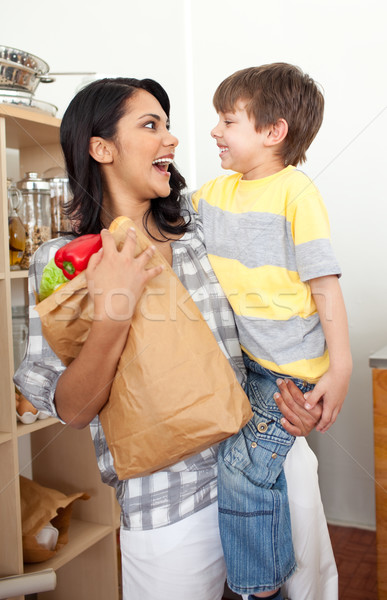 Cute Little boy unpacking grocery bag with his mother Stock photo © wavebreak_media
