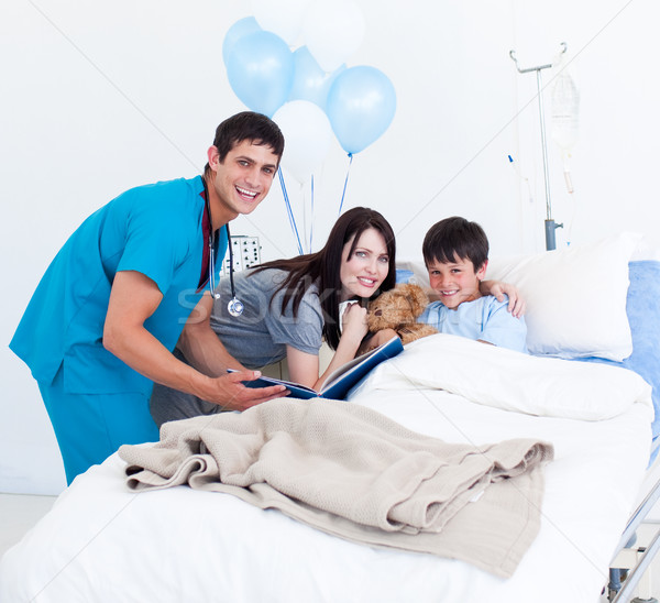 Smiling little boy, his mother and a doctor having a talk Stock photo © wavebreak_media